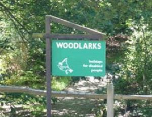 Woodlarks sign on Tilford Road Northbound