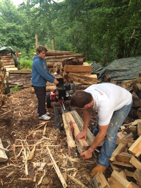 The Drews operating the log splitter